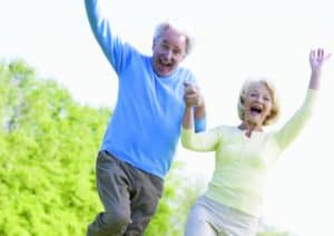Senior Couple Joy and Jumping After Savings on Life Insurance